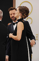 WWW.BLUESTAR-IMAGES.COM Actors Jason Sudeikis (L) and Olivia Wilde attend the 86th Annual Academy Awards held at Hollywood &amp; Highland Center on March 2, 2014 in Hollywood, California.<br /> Photo: BlueStar Images/OIC jbm1005  +44 (0)208 445 8588