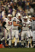 11 November 2006: Chris Horn makes an interception during Stanford's 20-3 win over the Washington Huskies in Seattle, WA. Pannel Egboh and Carlos McFall are also pictured.