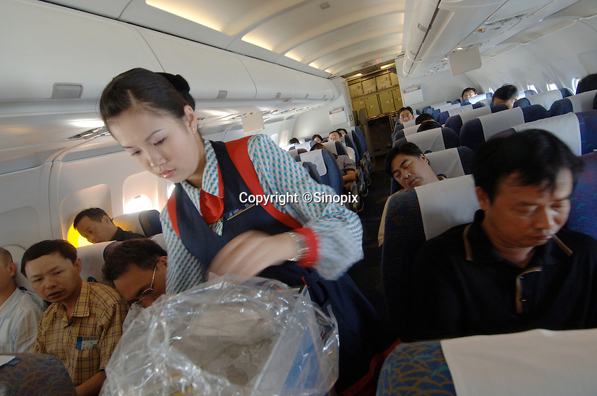 Passengers in a return flight in Nanning South China..