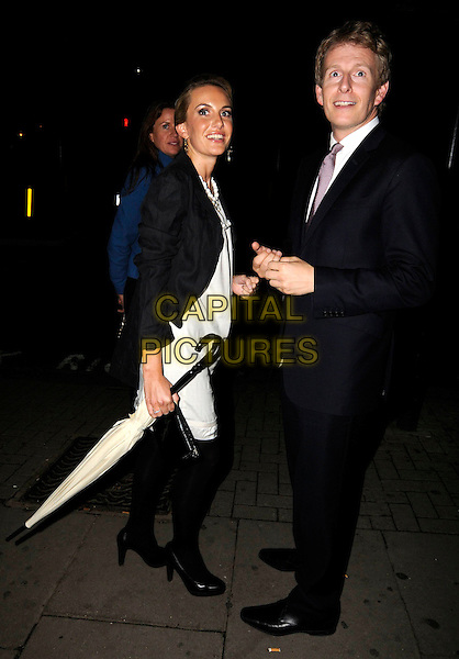 PATRICK KIELTY & GUEST.The Serpentine Gallery Summer Party after party at the Wellington Club, London, England..September 9th, 2008.full length blue navy suit tie white cream dress black tights umbrella jacket .CAP/ADM/SW.©SWCapital Pictures.