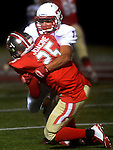(Everett Ma 091914) Tewksbury 7, Ryan Bednarek stops the ball carrier, Everett 25, Jackinson Joacine,  during the 4th quarter of the game, Friday, Sept. 19, 2014, at Everett Stadium. (Jim Michaud Photo) For Saturday