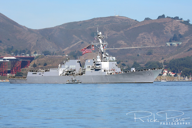 The guided-missile destroyer USS Pinckney (DDG 91) sails across San Francisco Bay during the Parade of Ships as part of San Francisco's 2010 Fleet Week activities. The Pinckney is an Arleigh Burke-class destroyer named for Cook First Class William Pinckney (1915-1975), who received the Navy Cross for his courageous rescue of a fellow crewmember onboard Enterprise (CV-6) during the Battle of Santa Cruz.