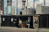 Bus stop in the 480 acre Nine Elms regeneration zone, London.  The zone will include two new tube stations, a new US Embassy building, and 20,000 new  homes with prices up to £9 million.