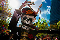 A gigantic Calaca figure, a Mexican icon representing the deceased, is carried on the street during the Day of the Dead parade in Mexico City, Mexico, 29 October 2016. Day of the Dead (Día de Muertos), a syncretic religious holiday combining the death veneration rituals of the ancient Aztec culture with the Catholic practice, is celebrated throughout all Mexico. Based on the belief that the souls of the departed may come back to this world on that day, people gather at the gravesites in cemeteries praying, drinking and playing music, to joyfully remember friends or family members who have died and to support their souls on the spiritual journey.