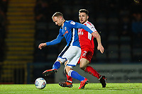 Matthew Done of Rochdale tries to knock the ball past Lewis Coyle of Fleetwood Town during the Sky Bet League 1 match between Rochdale and Fleetwood Town at Spotland Stadium, Rochdale, England on 20 March 2018. Photo by Thomas Gadd.
