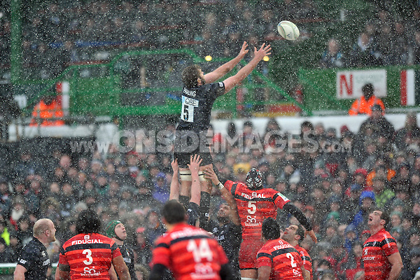 Geoff Parling rises high to win lineout ball. Heineken Cup match, between Leicester Tigers and Toulouse on January 20, 2013 at Welford Road in Leicester, England. Photo by: Patrick Khachfe / Onside Images