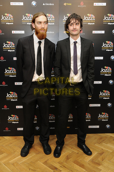 Beats and Pieces.Jazz FM Awards at One Marylebone. London, England, UK,.31st January 2013..full length black suit tie hands in pockets white shirt .CAP/BK/PP.©Bob Kent/PP/Capital Pictures.