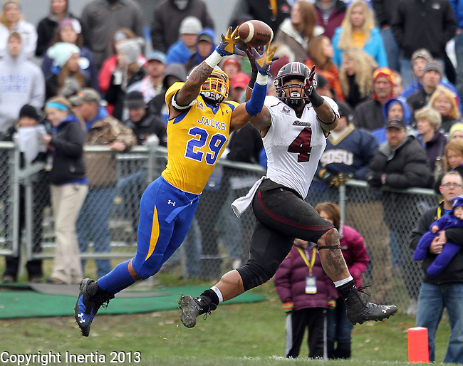 BROOKINGS, SD - OCTOBER 5:  Charles Elmore #29 from South Dakota State University intercepts a pass in front of MyCole Pruitt #4 from Southern Illinois in the second quarter Saturday afternoon at Coughlin Alumni Stadium in Brookings. Elmore returned the interception 89 yards for a touchdown. (Photo by Dave Eggen/Inertia)