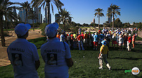 Rear view of the 16th tee where Andy Sullivan (ENG) is watched by Dave and Sue of Team Sulli, during the Final Round of the 2016 Omega Dubai Desert Classic, played on the Emirates Golf Club, Dubai, United Arab Emirates.  07/02/2016. Picture: Golffile | David Lloyd<br /> <br /> All photos usage must carry mandatory copyright credit (&copy; Golffile | David Lloyd)