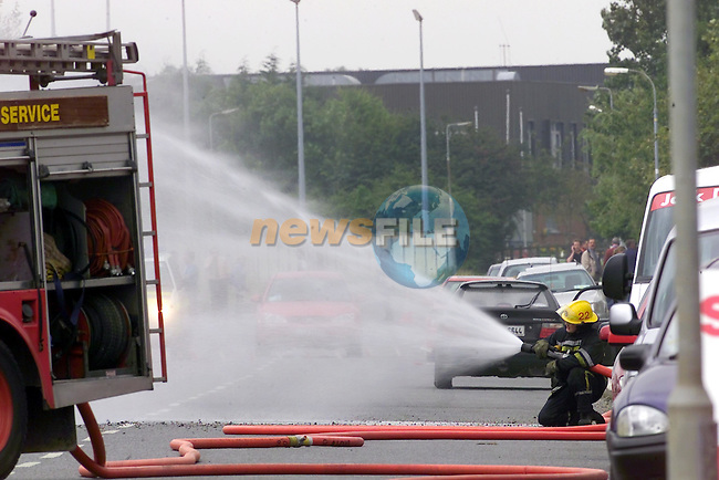 Fireman coverin the gas leek with water after the gas pipe was broken in the Industrial estate..Picture Fran Caffrey Newsfile...This Picture is sent to you by:..Newsfile Ltd.The View, Millmount Abbey, Drogheda, Co Louth, Ireland..Tel: +353419871240.Fax: +353419871260.GSM: +353862500958.ISDN: +353419871010.email: pictures@newsfile.ie.www.newsfile.ie