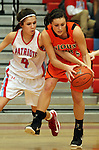 SIOUX FALLS, SD - JANUARY 22:  Sydney Miller #4 from Lincoln reaches over the back to knock the ball away from Hannah Nieman #24 from Washington in the first half of their game Tuesday night at Lincoln. (Photo by Dave Eggen/Inertia)