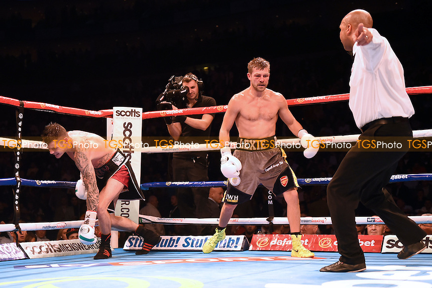 John Wayne Hibbert (grey/gold shorts) defeats Dave Ryan to win the Commonwealth (British Empire) super lightweight title during a Boxing show at the O2 Arena, London