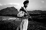 wana, waziristan, april 2004: a member of pakistan's frontier corp on evening patrol near the foothills of wana<br />