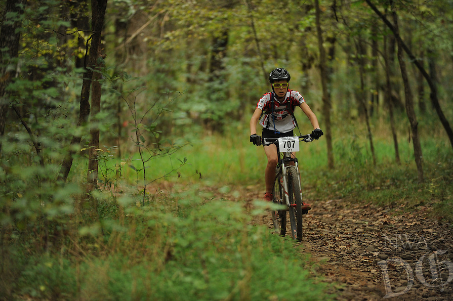 NWA Democrat-Gazette/ANDY SHUPE<br /> Carson Longmate of Bella Vista rides across Lee Creek Saturday, Sept. 19, 2015, during the Northwest Arkansas Mountain Bike Championships at Devil's Den State park.