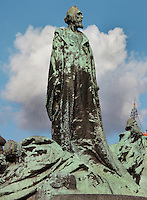 Detail of The Jan Hus Memorial by Ladislav Saloun, inaugurated 1915 to commemorate the 500th anniversary of Jan Hus' martyrdom, Old Town Square, Prague, Czech Republic. Hus, born 1370, was an influential religious thinker, philosopher, and reformer in Prague. He believed that Catholic mass should be given in the vernacular and Hus was burned at the stake in 1415. The huge monument depicts victorious Hussite warriors and Protestants who were forced into exile 200 years after Hus, and a young mother who symbolises national rebirth. The historic centre of Prague was declared a UNESCO World Heritage Site in 1992. Picture by Manuel Cohen