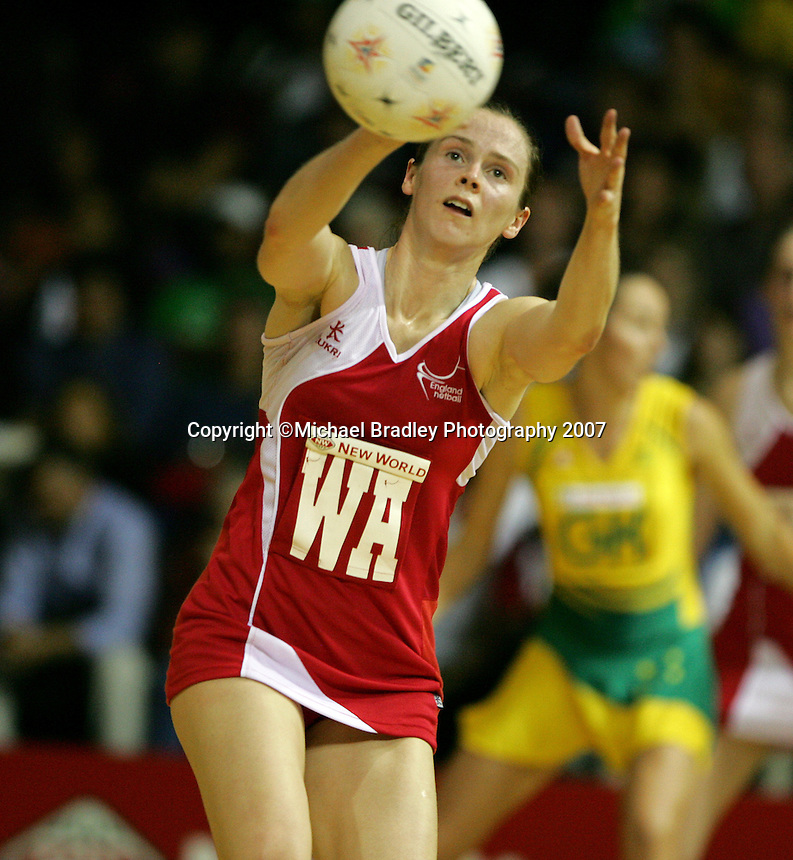 16.11.2007 England's Karen Atkinson in action during the Australia v England match at the New World Netball World Champs held at Trusts Stadium Auckland New Zealand. Mandatory Photo Credit ©Michael Bradley.