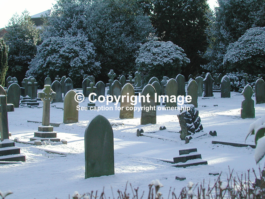 Graveyard snow scene, Farnborough, Hampshire, Hants, Hampshire, Hants, England, Britain, UK, 2000121441..Copyright Image from Victor Patterson, 54 Dorchester Park, Belfast, UK, BT9 6RJ..Tel: +44 28 9066 1296.Mob: +44 7802 353836.Voicemail +44 20 8816 7153.Skype: victorpattersonbelfast.Email: victorpatterson@mac.com.Email: victorpatterson@ireland.com (back-up)..IMPORTANT: If you wish to use this image or any other of my images please go to www.victorpatterson.com and click on the Terms & Conditions. Then contact me by email or phone with the reference number(s) of the image(s) concerned.