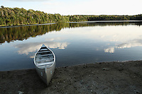 Woodford, VT, USA - August 19, 2007: A canoe rests beside a pond atop the Green Mountains of southern Vermont.