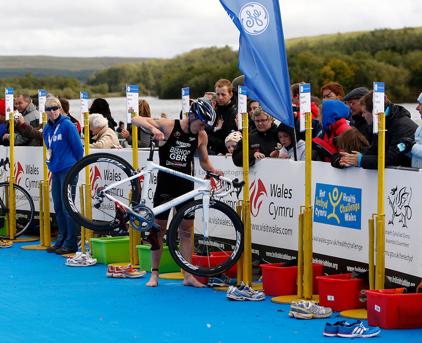 Photo: Richard Lane/Richard Lane Photography. GE Parc Bryn Bach Triathlon. 19/09/2010. David Bishop comes into transition from cycling to run during the Elite Mens' race.