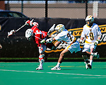 30 April 2011: Stony Brook Seawolves' midfielder Russ Bonanno, a Junior from Seaford, NY, in action against the University of Vermont Catamounts on Moulton Winder Field in Burlington, Vermont. The Catamounts fell to the visiting Seawolves 12-9 to conclude their America East season. Mandatory Credit: Ed Wolfstein Photo