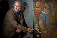 The painter and sculptor Fernando Botero, pose next to one of his paints while he supervises the assembly of his recently work know as VIACRUCIS, passion of the Christ  at the Museum of Antioquia in Medellín, Colombia. 01/04/2012. Photo by Fredy Amariles/VIEWpress.