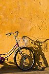 Bicycle against an ochre wall, Hoi An, Viet Nam