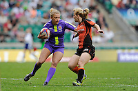 KayWilsonof England sidesteps Lorraine Laros of the Netherlands during the iRB Marriott London Sevens at Twickenham on Sunday 13th May 2012 (Photo by Rob Munro)