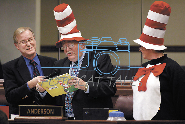 """Nevada Assemblyman David Parks, D-Las Vegas, holds the microphone as Assemblyman Bernie Anderson, D-Sparks, reads a Dr. Seuss book Friday morning, March 2, 2007, at the Legislature in Carson City, Nev. Anderson and Lynn Warne, right, with the Washoe Educatin Association, were recognizing """"Read Across America"""" day during the Assembly floor session.  .Photo by Cathleen Allison/Copyright Nevada Appeal"""
