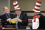 "Nevada Assemblyman David Parks, D-Las Vegas, holds the microphone as Assemblyman Bernie Anderson, D-Sparks, reads a Dr. Seuss book Friday morning, March 2, 2007, at the Legislature in Carson City, Nev. Anderson and Lynn Warne, right, with the Washoe Educatin Association, were recognizing ""Read Across America"" day during the Assembly floor session.  .Photo by Cathleen Allison/Copyright Nevada Appeal"