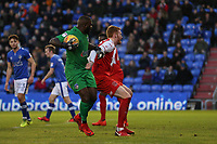 Fleetwood Town's Cian Bolger (left) battles with Oldham Athletic's Johnny Placide (right) during the Sky Bet League 1 match between Oldham Athletic and Fleetwood Town at Boundary Park, Oldham, England on 26 December 2017. Photo by Juel Miah / PRiME Media Images.