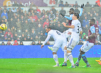 Pictured: Friday 26 December 2014<br /> Re: Premier League, Swansea City FC v Aston Villa at the Liberty Stadium, Swansea, south Wales, UK.<br /> <br /> Swansea's captain Ashely Williams header at goal