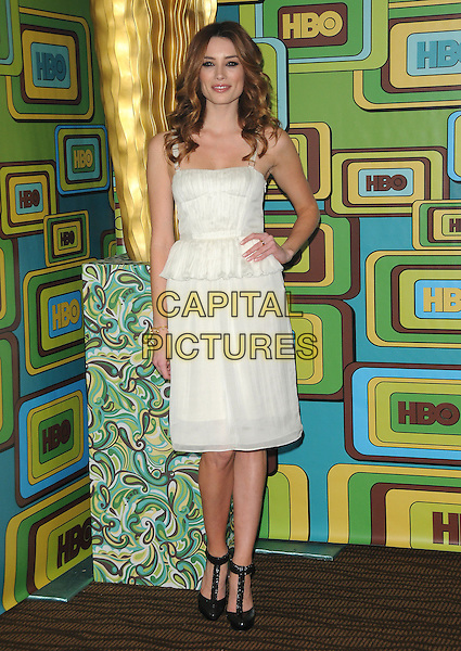 ARIELLE VANDENBERG.The HBO's Post Golden Globes Party held at The Beverly Hilton Hotel in Beverly Hills, California, USA..January 16th, 2011.full length white dress hand on hip black t-bar shoes .CAP/RKE/DVS.©DVS/RockinExposures/Capital Pictures.