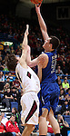 SIOUX FALLS, SD - MARCH 21:  Isaac Kortemeyer #50 from St. Thomas More knocks down a hook shot over Jacob Leighton #24 from Madison in the first half of their Class A Boys semifinal game Friday evening at the Sioux Falls Arena. (Photo by Dave Eggen/Inertia)