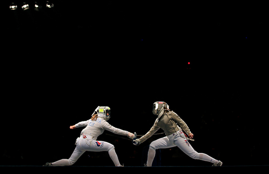 Becca Ward of the U.S., R,  during a bout with Mariel Zagunis (L) in the women's individual sabre events during day one of the 2008 Beijing    Olympics in Beijing, China, on Saturday, Aug. 9, 2008.  Mariel Zagunis went on to with the gold and Ward, the bronze.