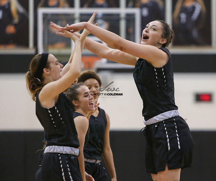 The Cedar Park Timberwolves take the court before the start of a girls high school basketball game between the Vandegrift Vipers and the Cedar Park Timberwolves at Vandegrift High School in Austin, Texas on November 14, 2017.