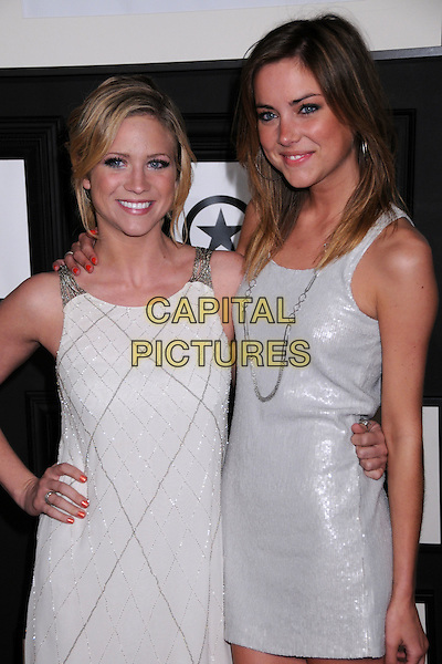 BRITTANY SNOW & JESSICA STROUP.Target & Converse One Star Movie Awards After Party at The Lot,Hollywood, California, USA..June 1st, 2008.half length white dress black jacket silver hand on hip necklace  .CAP/ADM/BP.©Byron Purvis/AdMedia/Capital Pictures.