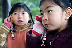 Elementary school children use KDDI Corp.'s mamorino mobile phone in Tokyo, Japan on Nov. 22, 2009. .Photographer: Robert Gilhooly