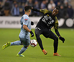 Felipe Gutierrez of Sporting KC (left) and Abdiel Ayarza of Independiente vie for the ball. Sporting KC defeated Club Atletico Independiente 3-0 in a CONCACAF Champions League quarterfinal game at Children's Mercy Park on March 14, 2019.