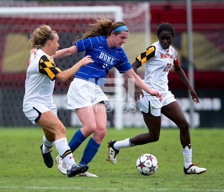 Kelly Cobb (9) of Duke keeps the ball away from Sarah Fichtner (2) and Shade Pratt (22) of Maryland at Ludwig Field on the campus of the University of Maryland in College Park, MD. DC. Duke defeated Maryland, 2-1.