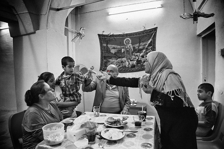 4.4..2015, Kirkuk,Iraq: Widad (Sunni Muslim) visiting Ghanim's house (Christian) for a friendly tea session.