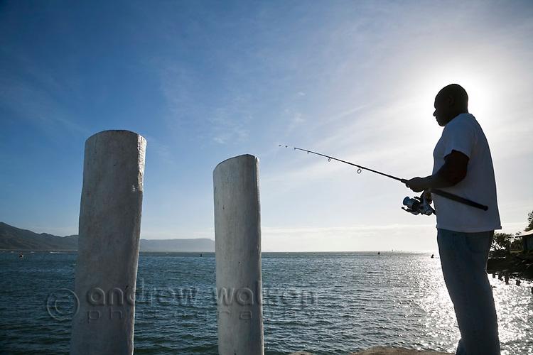 Man fishing at wharf.  Cooktown, Queensland, Australia