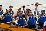 Vancouver, Canada, Aug 8th 2009. World Police and Fire Games, Dragon Boat Competition.  The Hong Kong Dragon boat team celebrates after winning the Mixed Open 20 Grand Championship.  Photo by Gus Curtis