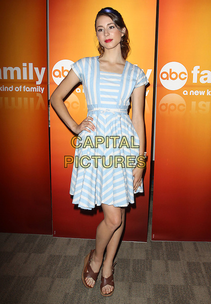 TROIAN AVERY BELLISARIO.Disney/ABC Television Group Press Junket held At The ABC Television Network Building, Burbank, California, USA..May 15th, 2010.full length dress hand on hip white blue striped stripes brown open toe sandals .CAP/ADM/KB.©Kevan Brooks/AdMedia/Capital Pictures.