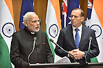 AUSTRALIA, Canberra : Indian Prime Minister Narendra Modi (L) with Australian Prime Minister Tony Abbott (R) during a press conference at Parliament House, Canberra on November 18, 2014. AFP PHOTO / MARK GRAHAM