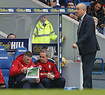 Jim Stewart and David Weir study the tactics during the game