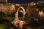 Ruins of a stone arch in the Tower of David or the Citadel in the Armenian Quarter of the Old City of Jerusalem at dusk.  The Old City of Jerusalem and its Walls is a UNESCO World Heritage Site