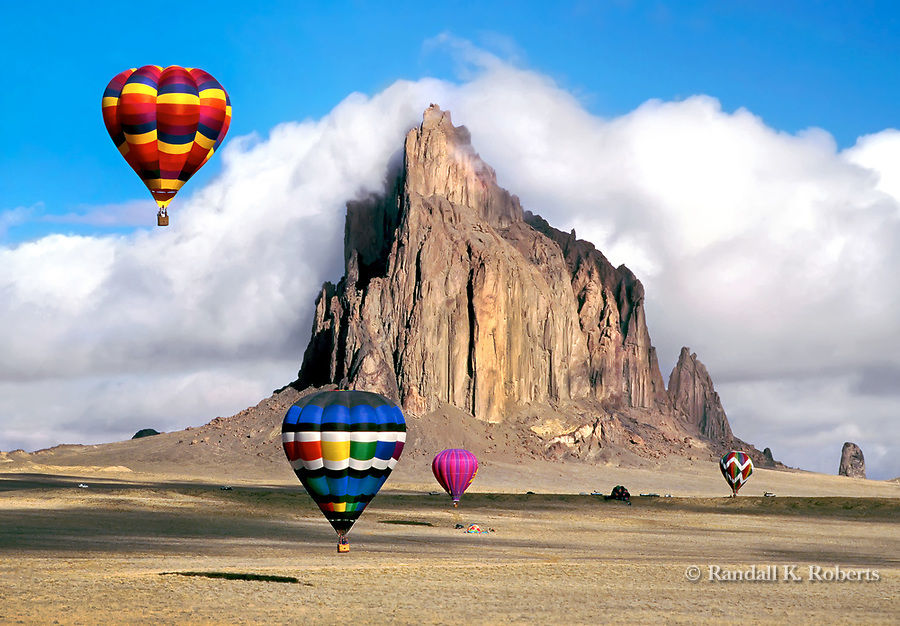 Hot air balloons soar over Shiprock during the Shiprock Ballloon Fiesta, New Mexico.
