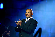 Canton, Ohio - August 1, 2014: Aeneas Williams is introduced before receiving his his gold jacket during the Pro Football Hall of Fame's class of 2014 enshrinement dinner in Canton, Ohio  August 1, 2014. During his career, Williams had nine interceptions returned for a touchdown and was named to eight Pro Bowl teams.  (Photo by Don Baxter/Media Images International)