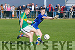 Skellig Rangers Bernard Walsh advances the ball as Renard's Conor O'Leary tries to make the block.