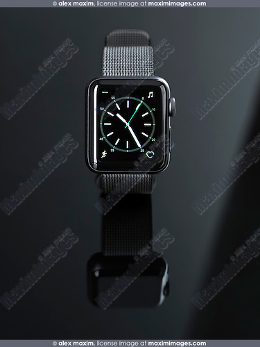 Apple Watch smartwatch with analogue clock dial on display front view isolated on black background
